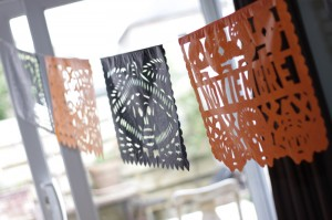Orange and purple papel picado for the Day of the Dead