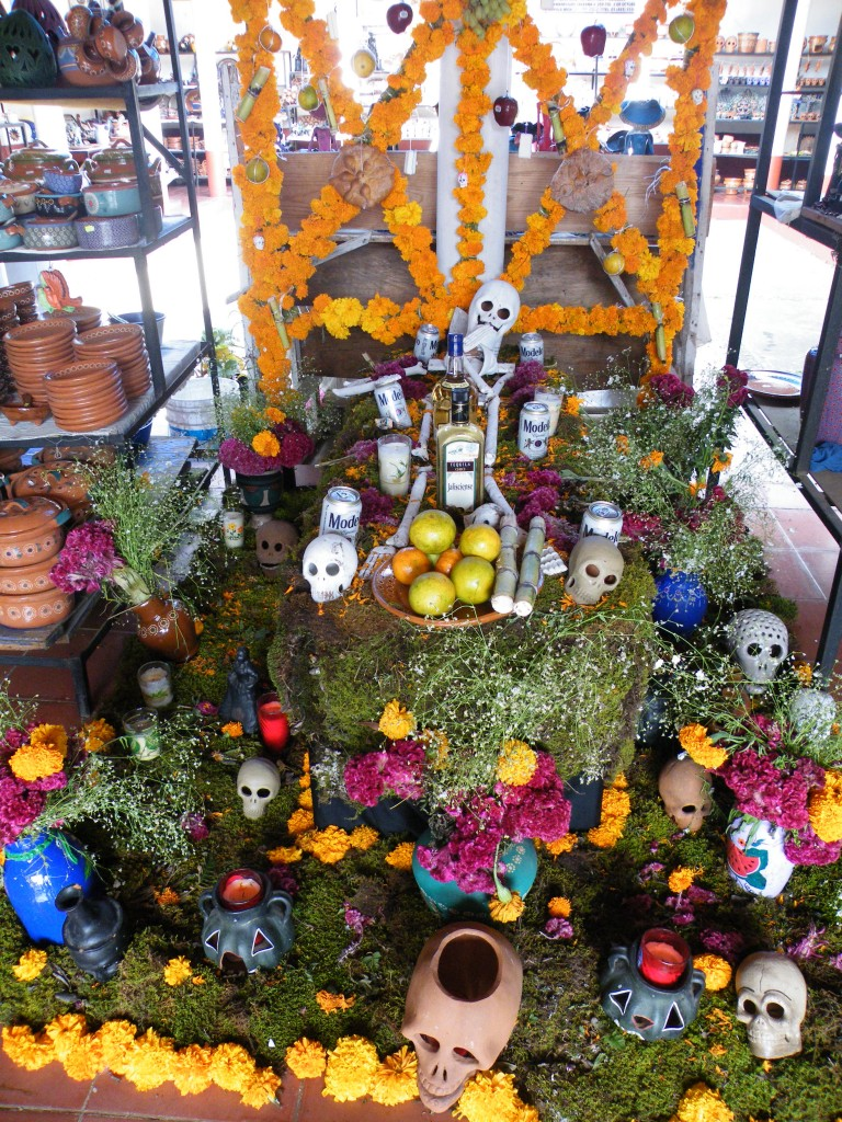 Sugar cane, beer and tequila join the skulls and marigolds