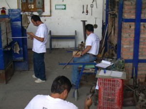 Glass blowers at work