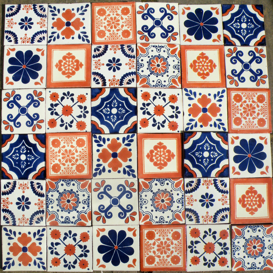 A patchwork of 36 10.5cm x 10.5cm blue and terracotta tiles