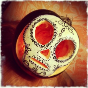 Carved pumpkin decorated with acrylic paint