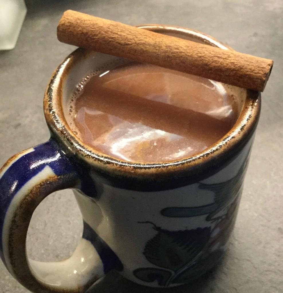 A steaming mug of champurrado