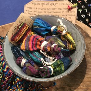 Six Worry Dolls in their bags