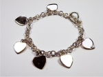 Caoba > heart charm bracelet - click for more info
